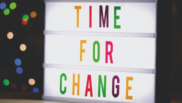 Time to Change written on a sign in multicolour