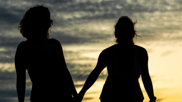Two women silhouette against the sunset